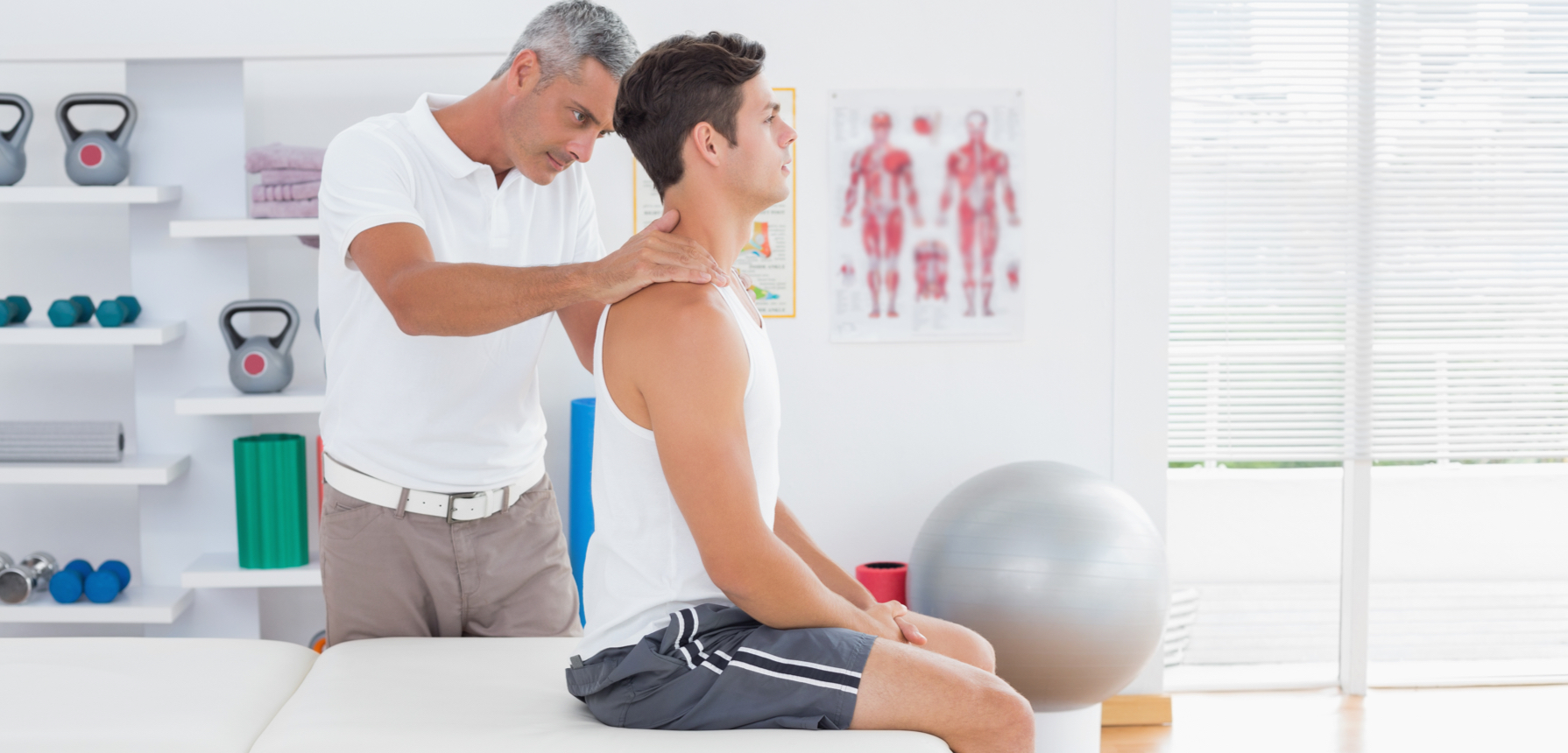 chiropractor helping client with Neck pain